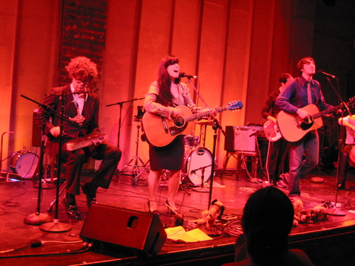 KaiserCartel, with Christian Gibbs, left, helping out, play the Zipper Theater in Midtown Manhattan in September 2008.