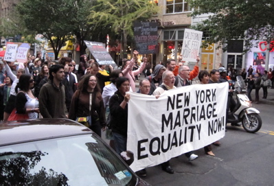 New Yorkers marching on 14th Street in Manhattan at 6 p.m. Tuesday.