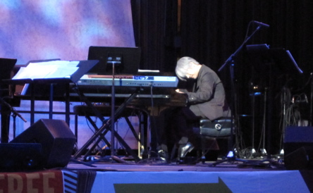 Sakamoto at the piano, performing an untitled solo piece.