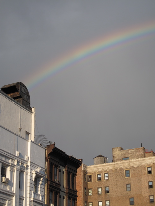 There's something very hopeful about a rainbow. This one appeared over 9th Street in Park Slope, Brooklyn, after a sunshower last Saturday. It stopped people in their tracks.