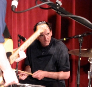 Percussionist Dave Weckerman seems content to stay in the background.