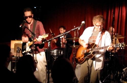Glenn Mercer and Bill Million attack their guitars.