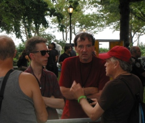 The Feelies' Glenn Mercer and Dave Weckerman talk to a fan in Battery Park.