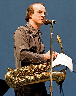 Ken Thomson plays saxophone in Asphalt Orchestra.