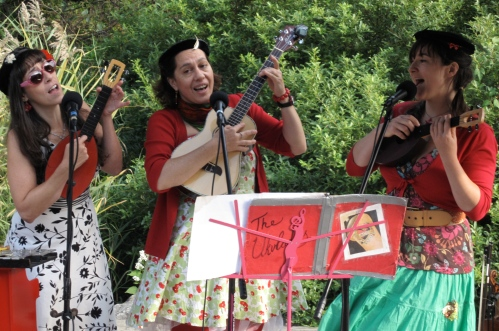Three Ukuladies sing and play their namesake instruments in the Children's Adventure Garden at the New York Botanical Garden. (Copyright 2009, Steven P. Marsh)