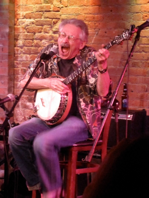 Peter Stampfel torturing a banjo and assaulting our ears at the Gerdes Folk City 50th Reunion in 2010. (Photo 2010, Steven P. Marsh)