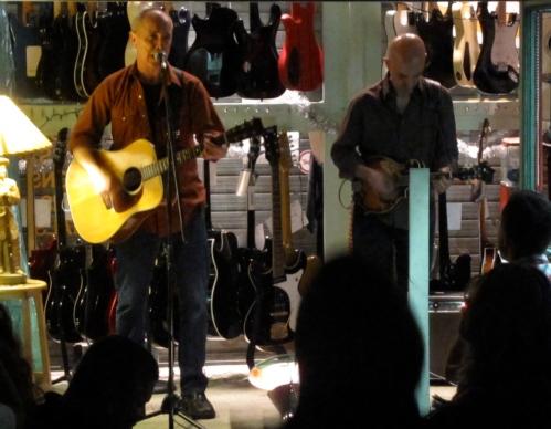 Freedy Johnston, left, with James Mastro at Mastro's Guitar Bar store in Hoboken on June 12, 2010. (Photo © 2010, Steven P. Marsh)