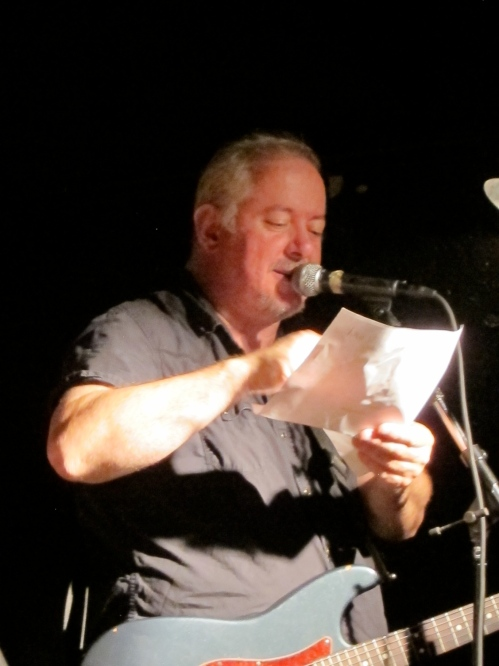 Jon Langford with the set list at Maxwell's. (Photo © 2013, Steven P. Marsh)