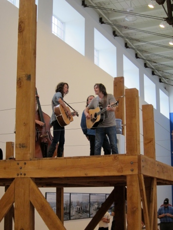 Sarah Lee Guthrie and Johnny Irion perform atop an artwork in a gallery at the Massachusetts Museum of Contemporary Art in North Adams, Mass., during the Solid Sound festival in 2011. (Photo © 2011, Steven P. Marsh)