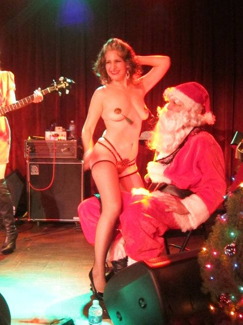 It just wouldn't be Christmas without a stripper, uhhh, burlesque artist, would it?