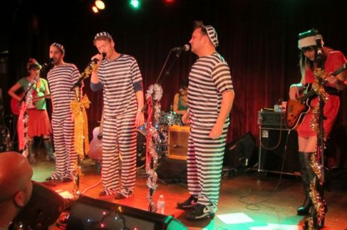 The members of Poundcake got into the spirit by donning appropriate costumes for their performance of  'Christmas in Jail.""
