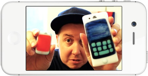 Tim Fite with two Phoneys, the product of his latest project. (Kickstarter)