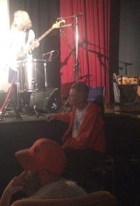 Jonathan Demme at the feet of Feelies bassist Brenda Sauter.
